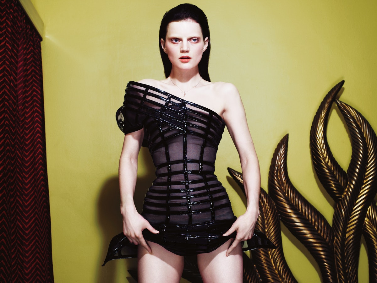 Alexander McQueen's patent-leather and net dress, to order, at Alexander McQueen, New York. Model's own necklace.