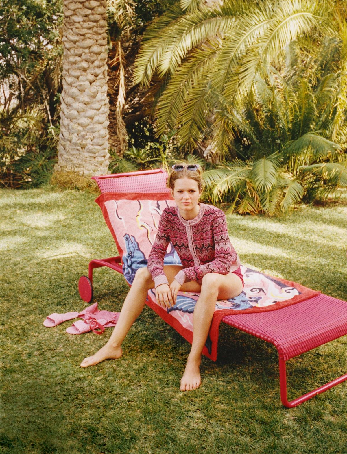 Alberta Ferretti cardigan; Hesperios bikini bottom; Miu Miu sunglasses and sandals; Hermès towel; Li...