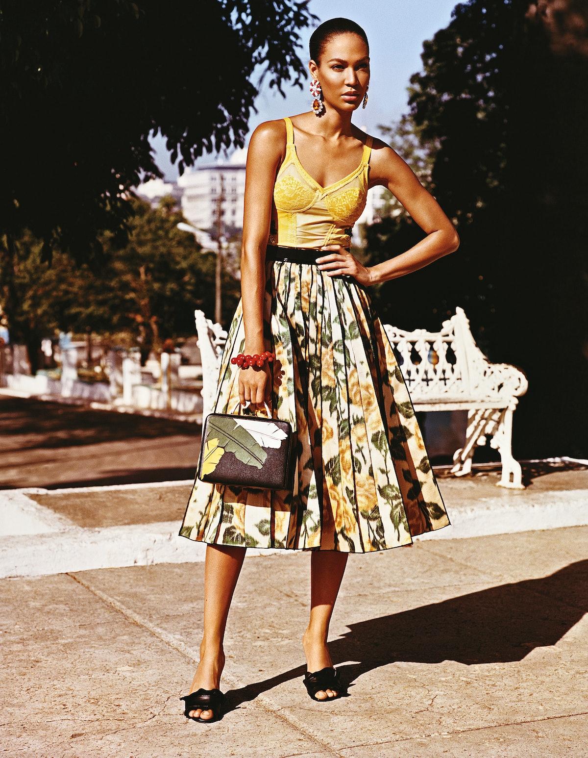 Rosamosario leotard; Marc Jacobs skirt; Miu Miu earrings; Kenneth Jay Lane bracelet; Mark Cross bag;...