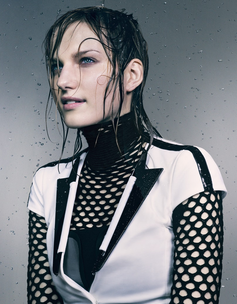 Emporio Armani cotton-blend jacket and silk corset top. Alexander Wang merino wool fishnet turtleneck.