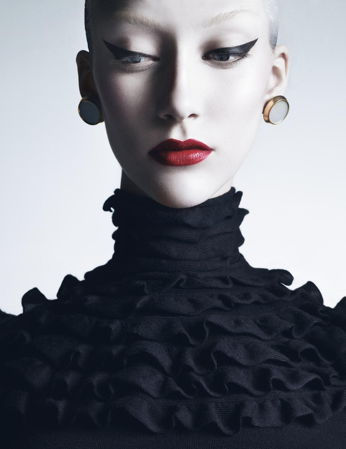 Valentino's silk and cashmere turtleneck, at Valentino. M&J Savitt earrings.