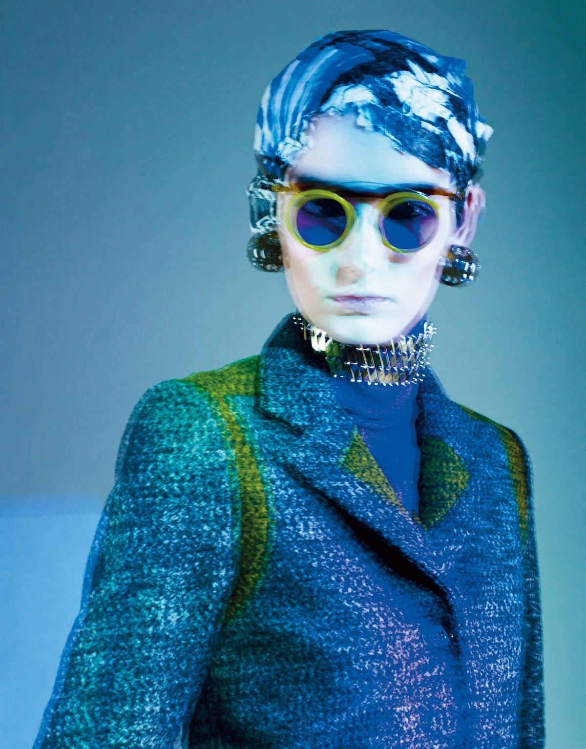 Kenzo wool blend jacket. Louis Vuitton polyester turtleneck. Prada sunglasses; Sharra Pagano earring...