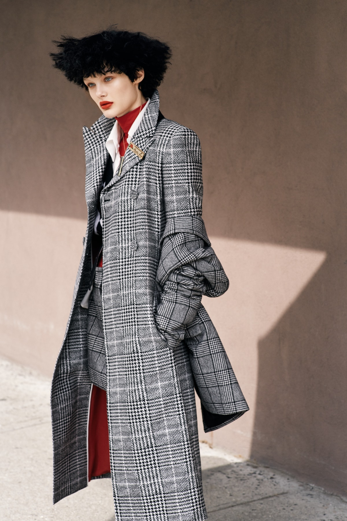 Tibi blazer and skirt; Fendi coat and shirt; Thom Browne vest; Tees by Tina turtleneck. Beauty note:...