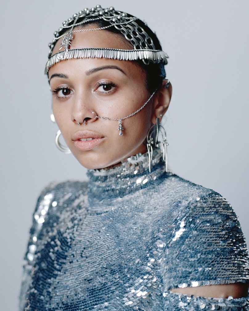 Venus X wears a Helmut Lang turtleneck; Dannijo necklace (top, worn as headpiece) and earring (left ear); Chrishabana ear cuff (left ear); Lynn Ban necklace (center, worn as headpiece); Jill Platner necklace (worn as head band); Sophie Buhai earring (right ear); Chrome Hearts necklace (worn as nose chain); her own nose ring.