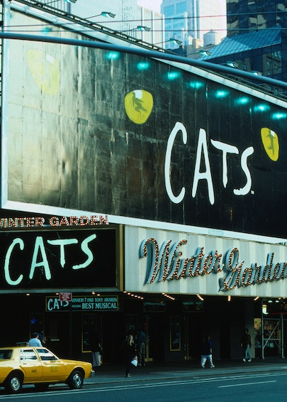 Broadway Theatre advertisements for Cats the musical above a theatre in the Theatre District - New York City, New York