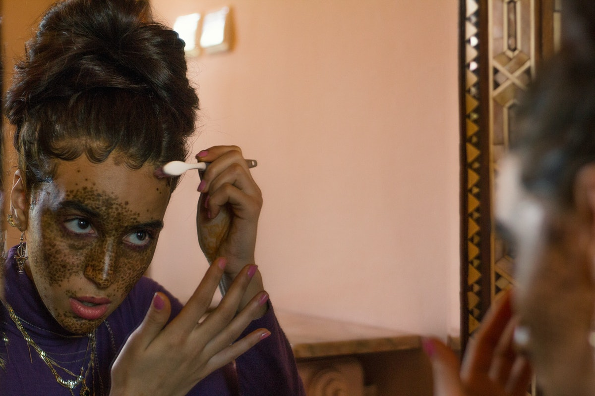young beautiful women doing makeup front of the mirror