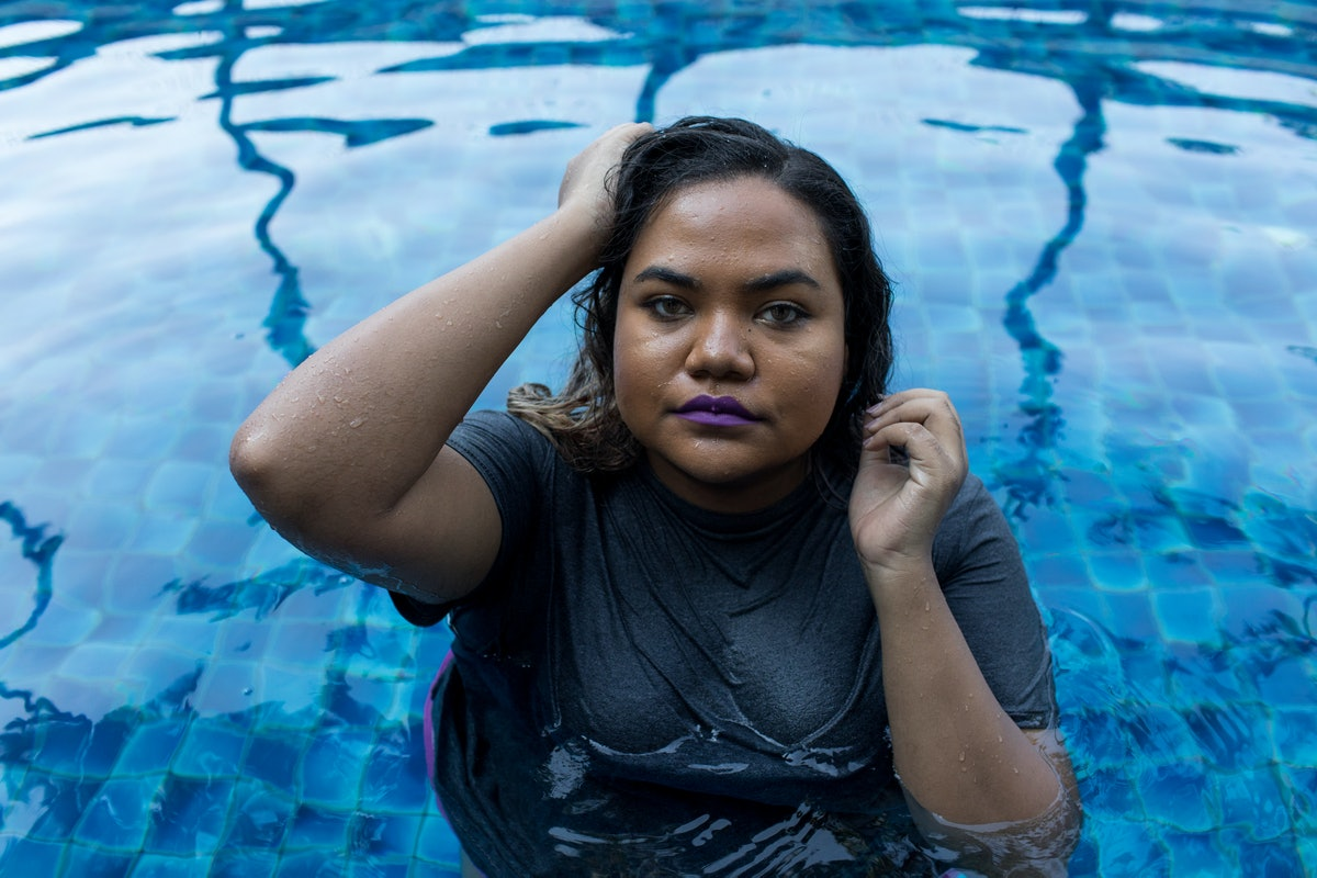 Young Beautiful Mixed Race Woman In Pool