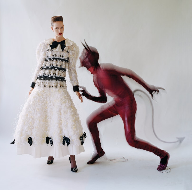 From left: Chanel Haute Couture dress; Lagos earrings; Wolford tights; Manolo Blahnik pumps. Spencer Horne devil costume. Beauty note: Defy your inner demon with Maybelline Color Sensational the Loaded Bolds Lipstick in Smoking Red.