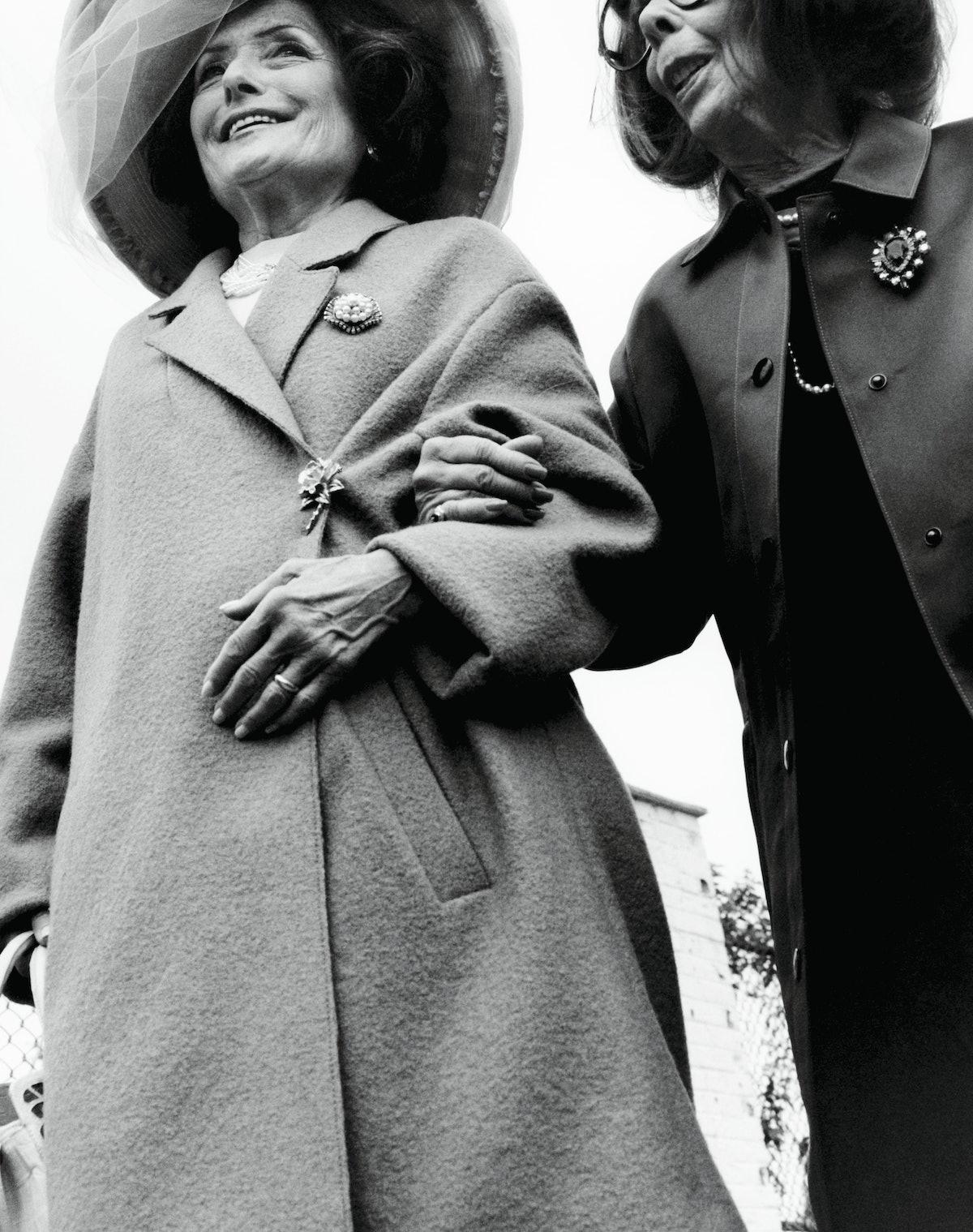 Boss coat and top; Kokin hat; Elizabeth Locke earrings; necklace from Beladora, Beverly Hills; (from...