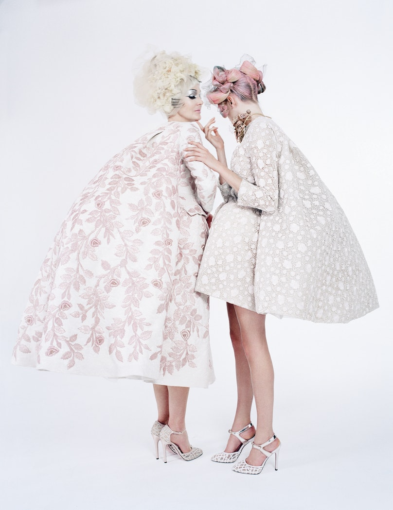 from left: Birley wears Giambattista Valli Haute Couture coat and shoes; Ashley Lloyd headpiece. Delevingne wears Giambattista Valli Haute Couture dress and shoes; Luigi Scialanga for Giambattista Valli Haute Couture necklace. Beauty note: Perfect every inch of leg with Valmont Body Time Control Cellular Refining Scrub. For stores, prices, and more, see Backstory, page 148.