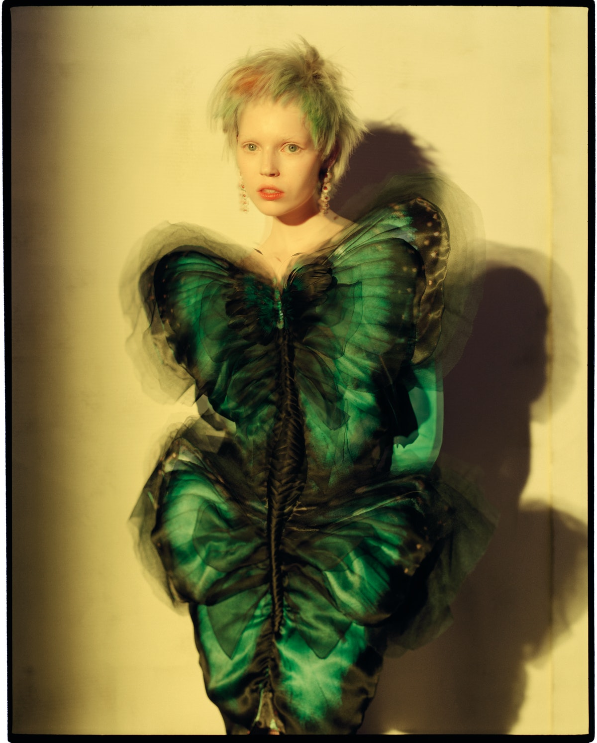 Gaultier Paris dress and gloves; Lydia Courteille earrings.