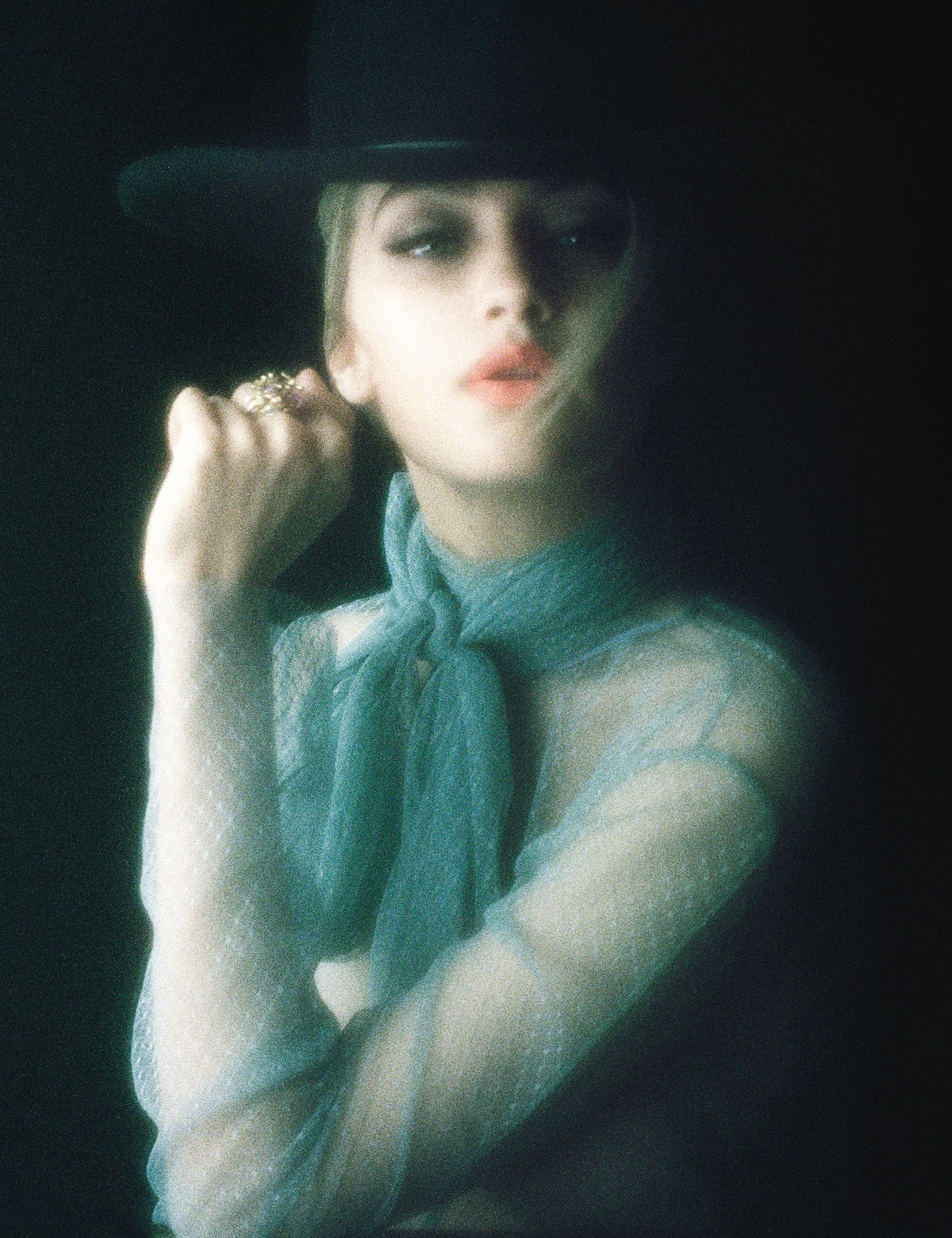 Gucci shirt; Worth & Worth by Orlando Palacios hat; Dior Fine Jewelry ring. Beauty note: A pout perk...