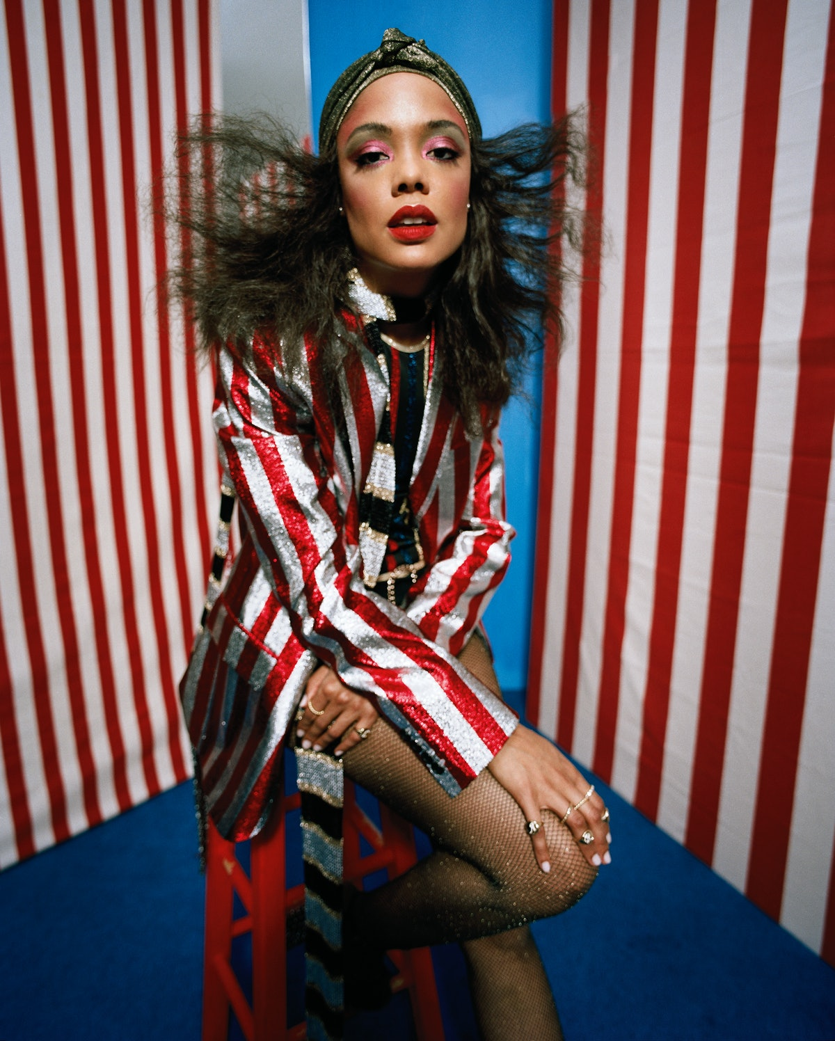 Saint Laurent by Hedi Slimane jacket and shoes; Hilfiger Collection swimsuit and scarf; L. Erickson ...