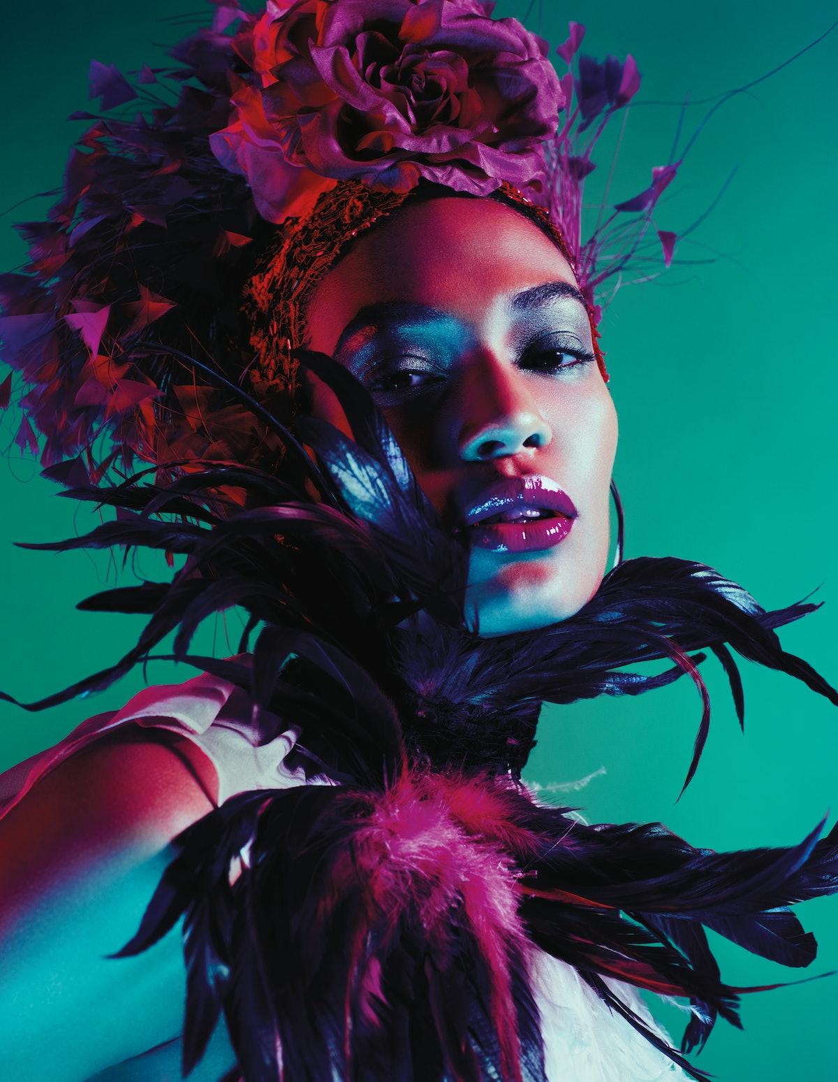 Tom Ford's ostrich feather top. M&S Schmalberg Inc. silk flowers; Kokin headband; Jennifer Behr veil...