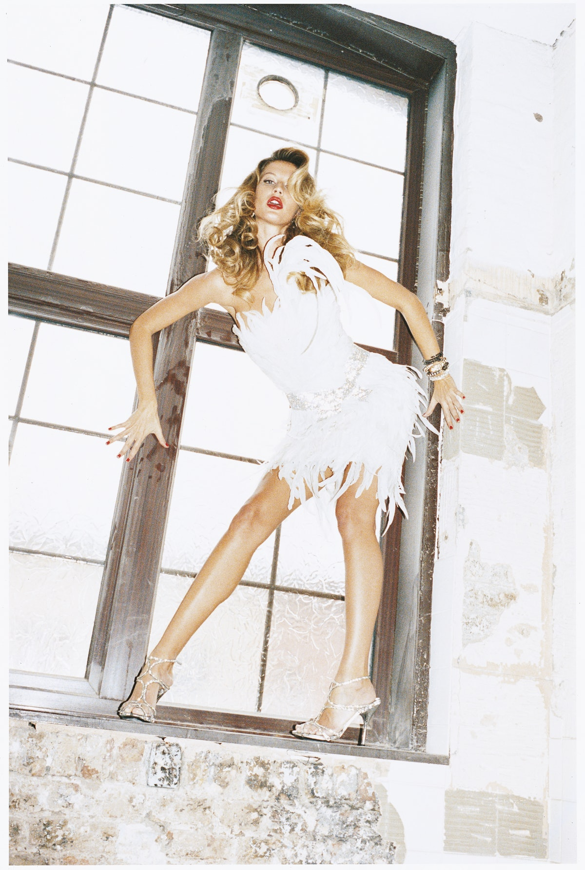 """In """"Hothouse Flower,"""" page 138, Juergen Teller captures Gisele Bündchen in the season's frothiest fa..."""