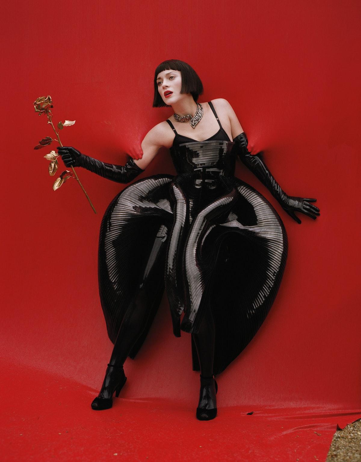 """<cnp:caption xmlns:cnp=""""http://condenast.com""""><b xmlns="""""""">Iris Van Herpen</b> plastic dress. <b xmln..."""