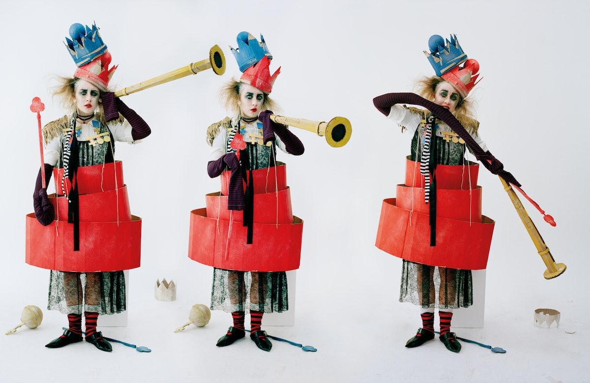 Rochas dress; Philosophy di Lorenzo Serafini dress (underneath); Prada striped top and white socks (...