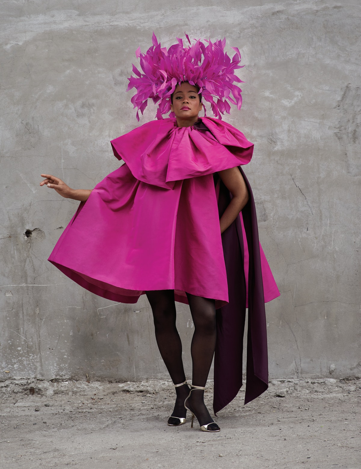 More than ready for her close-up in a Valentino Haute Couture dress and sandals; Philip Treacy for V...