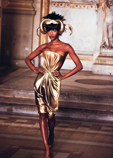 Naomi Campbell walking the runway in gold