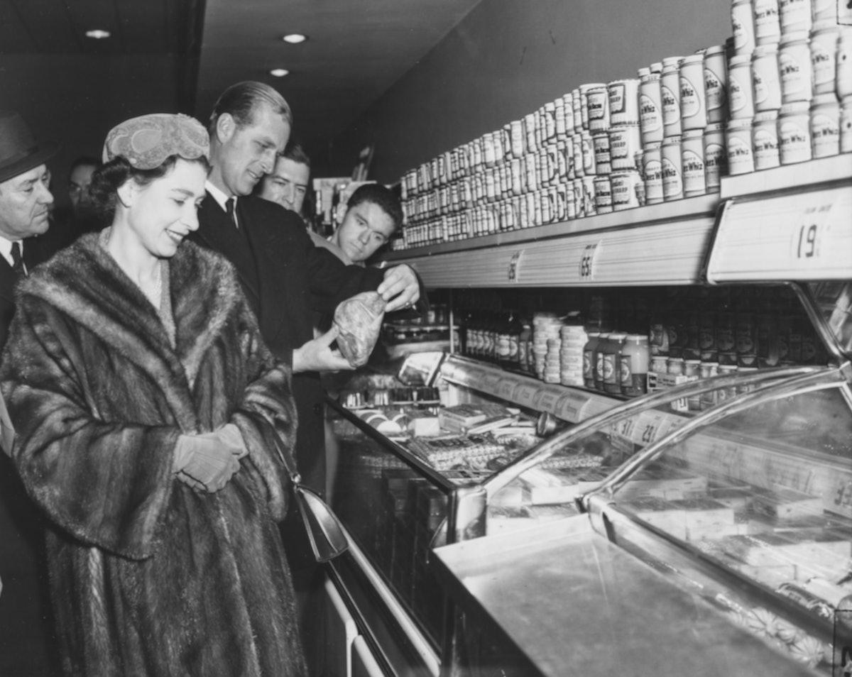 Queen Elizabeth II And Prince Philip Visit A Supermarket