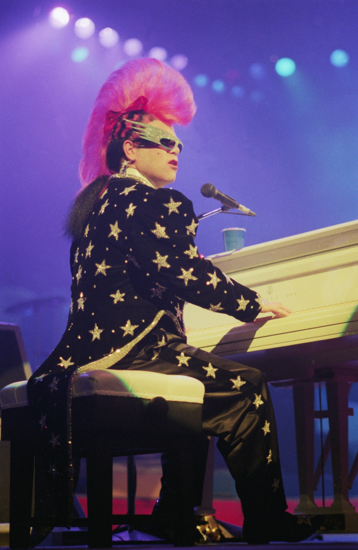 Elton John Performs with Mohawk Hairdo