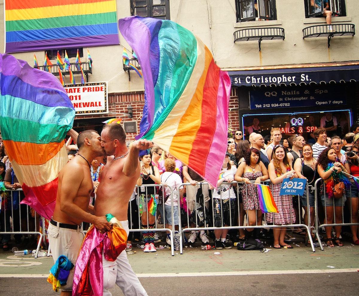 Gay Pride Parade - Two Men Kissing