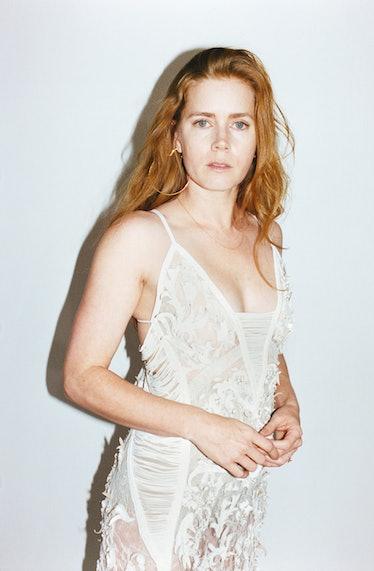 Adams wears Roberto Cavalli silk lace dress; Pure Dead Brilliant 22k gold vermeil hoop earrings and ...