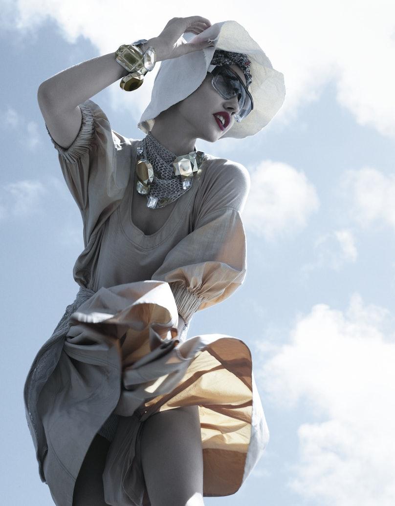 Donna Karan Collection's cotton poplin dress, at select Bloomingdale's stores, 866.240.4700; Elie Tahari's linen and silk cardigan (tied at waist), at Elie Tahari, elietahari.com. Marni hat and sunglasses; B&J fabric (worn on head); Marc Jacobs neckpiece and bracelet.