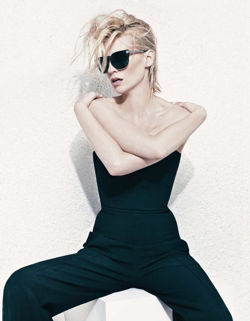 Céline's rayon crepe jumpsuit with leather trim. Versace sunglasses.