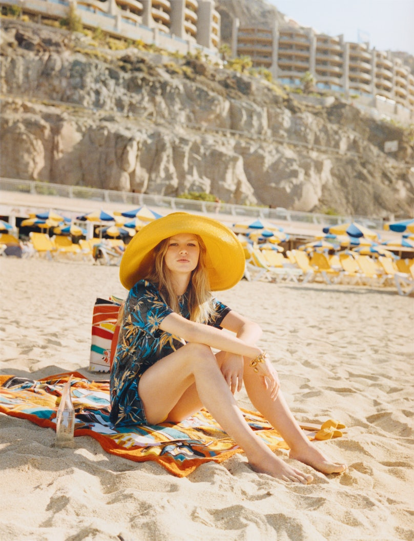 Marni top; Albertus Swanepoel hat; Ancient Greek Sandals sandals; Hermès bag and towel. Beauty note: Sun safely with Burt's Bees Baby Nourishing Mineral Sunscreen SPF 30.