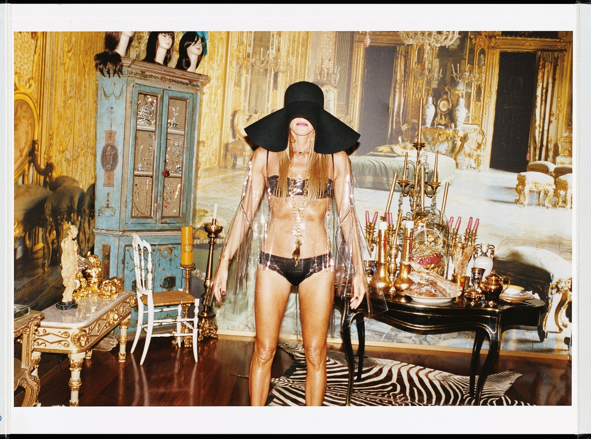 As slim as one of her nonslip hangers, Dello Russo wears an Yves Saint Laurent hat and transparent cape and a Dolce & Gabbana bra and briefs. Her Chinatown hair mannequins (wearing Philip Treacy hats) look on from above in apartment number two.
