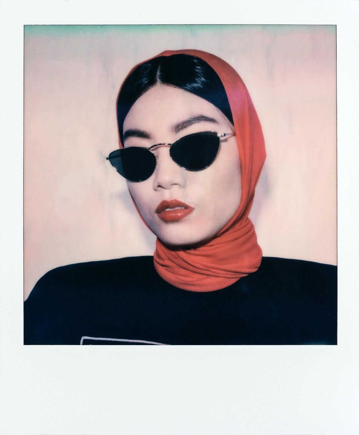 Versace hood and sweatshirt; Oliver Peoples sunglasses.
