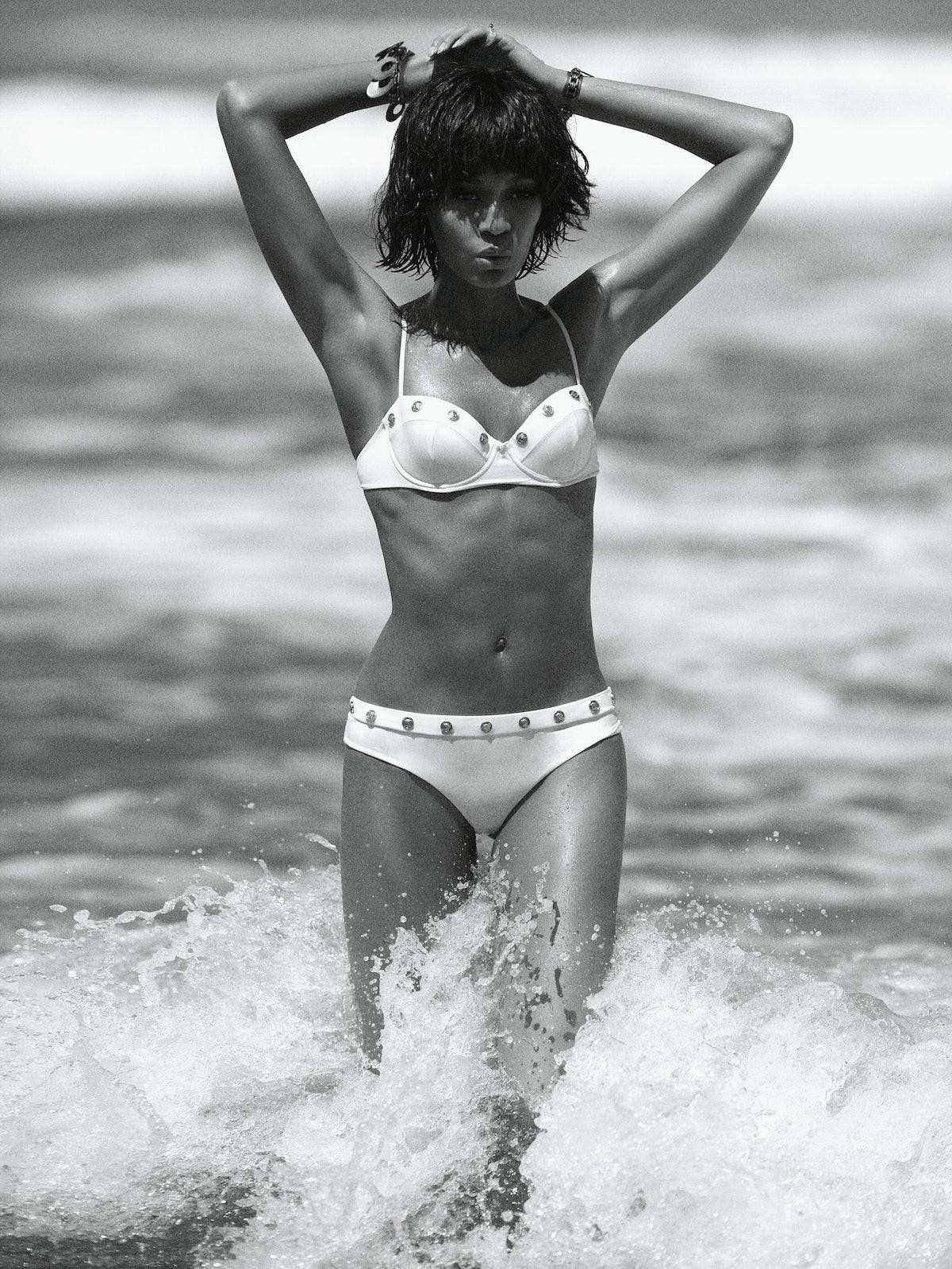 Versace swimsuit. Beauty note: Flaunt a bikini-ready body with Soap & Glory Sit Tight Intense XS Body Firming Serum.