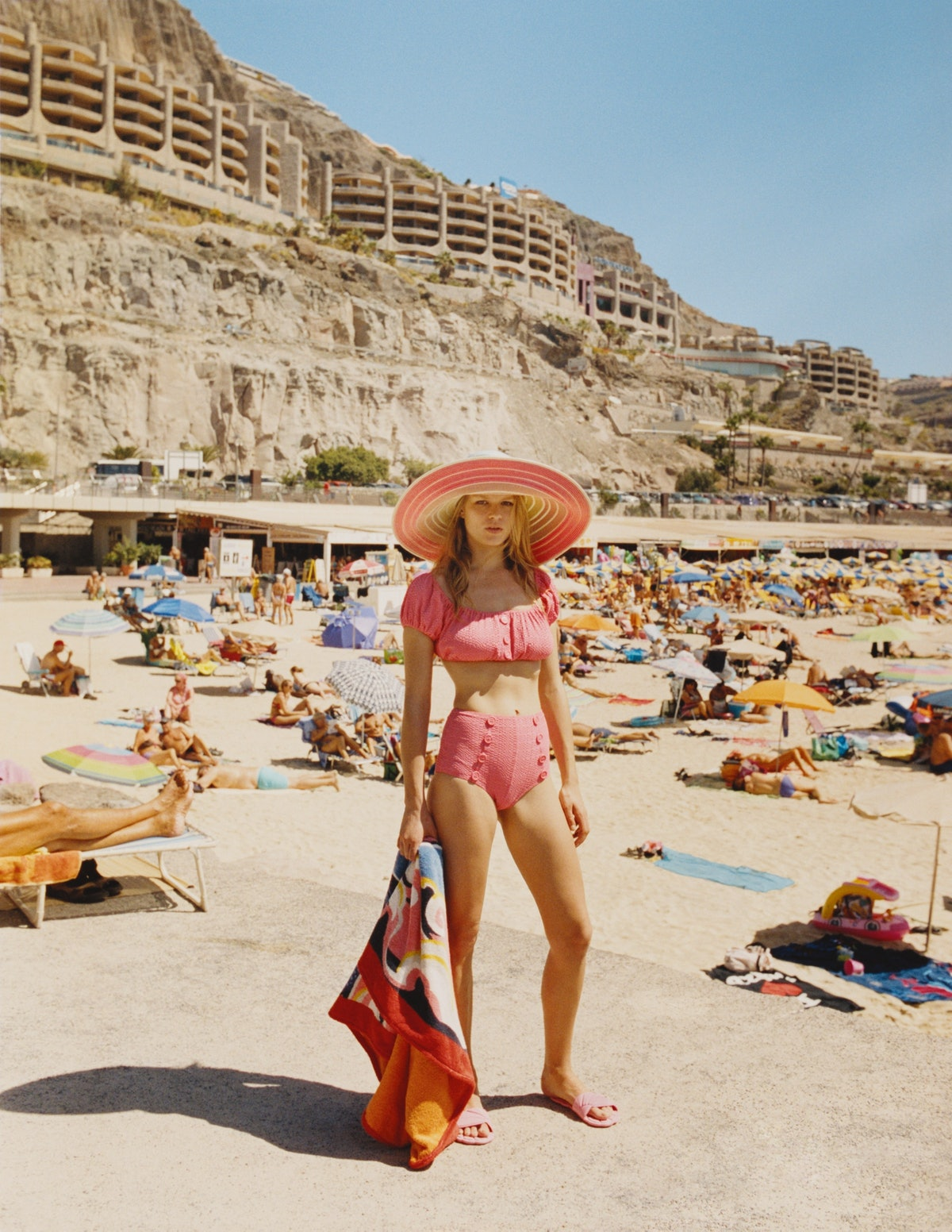 Lisa Marie Fernandez swimsuit; Missoni hat; Miu Miu sandals; Hermès towel.