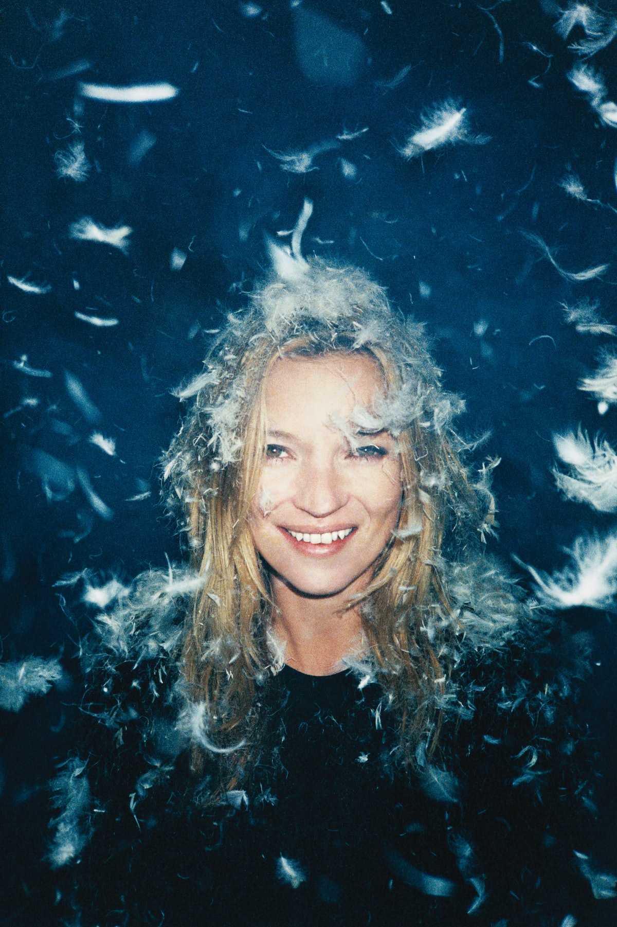"""Ryan McGinley, one of photography's brightest young stars, takes Kate Moss on an ethereal journey in """"Dreamgirl,"""" page 162. Here, MaxMara's cotton sweater.DreamgirlKate Moss gets gorgeous in fur and feathers."""