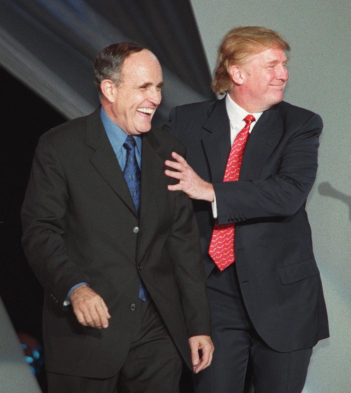 New York City Mayor Rudy Giuliani (L) jokes with D
