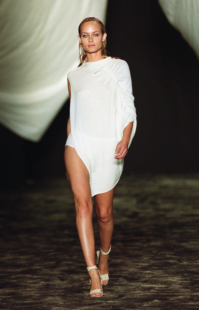 A model wears a white tunic during the John Bartle