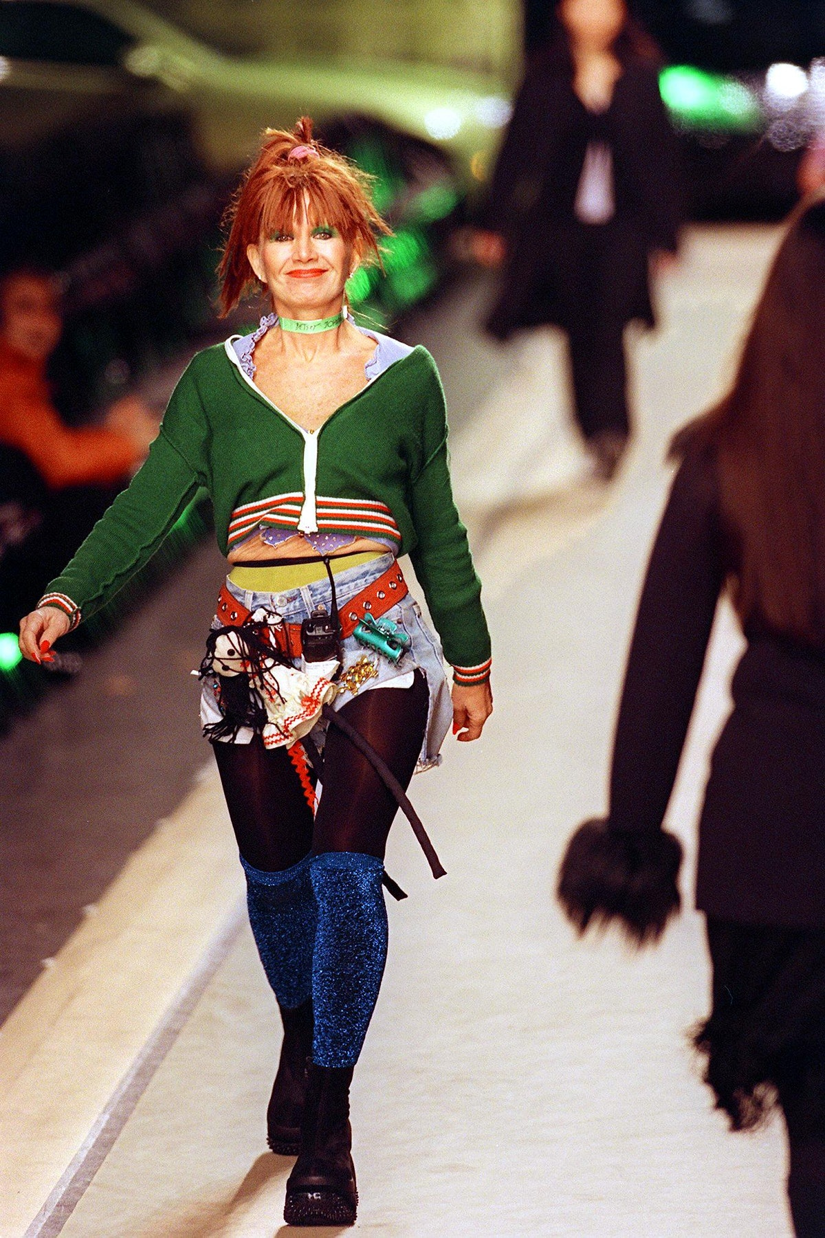 Designer Betsey Johnson (L) walks down the runway
