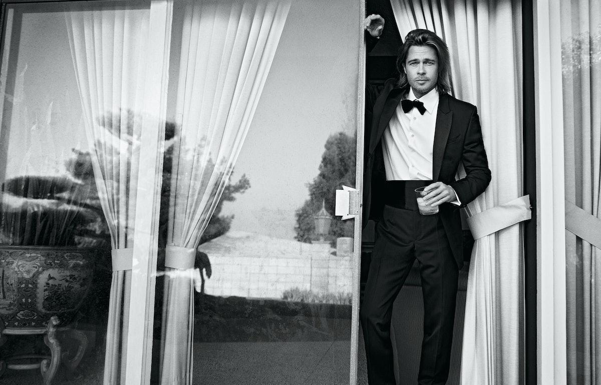Brad Pitt holding a glass