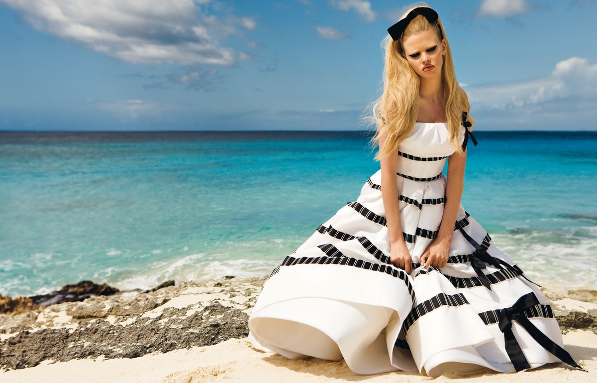 """Photographers Inez van Lamsweerde and Vinoodh Matadin get swept away in Turks and Caicos in """"From Here to Eternity,"""" page 80. Here, Dior Haute Couture's silk dress, to order, 800.929.DIOR. Mokuba ribbon (worn in hair)."""