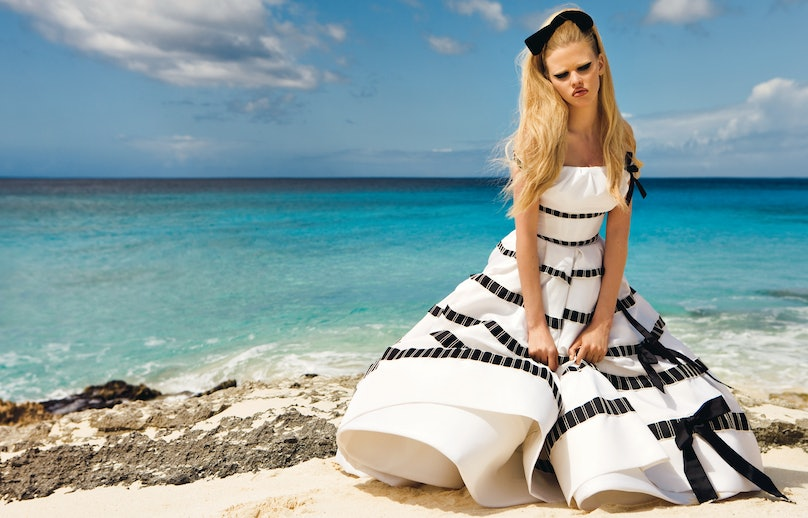 "Photographers Inez van Lamsweerde and Vinoodh Matadin get swept away in Turks and Caicos in ""From Here to Eternity,"" page 80. Here, Dior Haute Couture's silk dress, to order, 800.929.DIOR. Mokuba ribbon (worn in hair)."