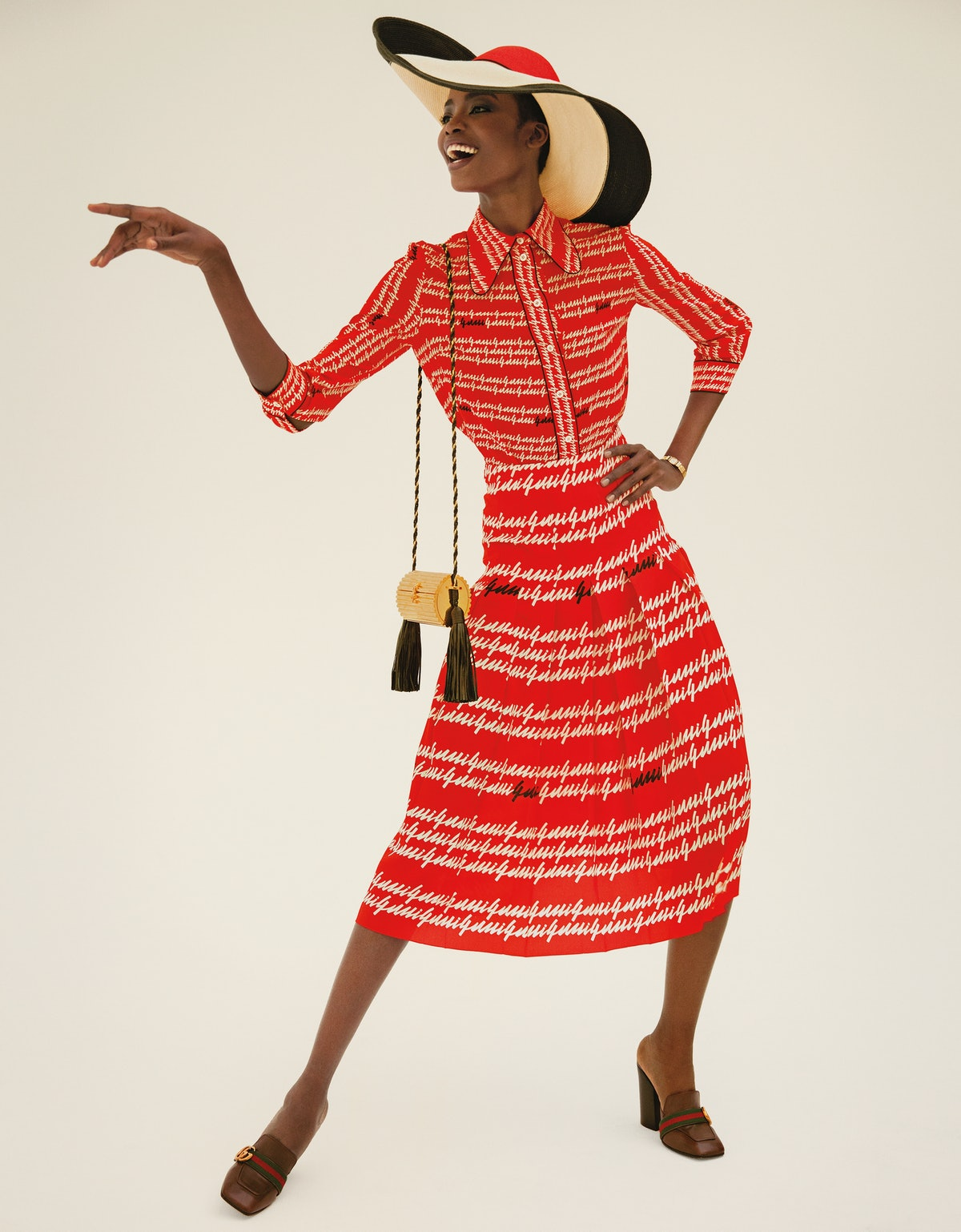 Beverly Johnson was the first African-American to appear on the cover of Vogue. Here, Maria Borges, who is making waves of her own, channels that barrier-breaking beauty in a Gucci shirt, skirt, and shoes; Eugenia Kim hat; Movado watch from Camilla Dietz Bergeron, New York; Saint Laurent by Hedi Slimane bag.