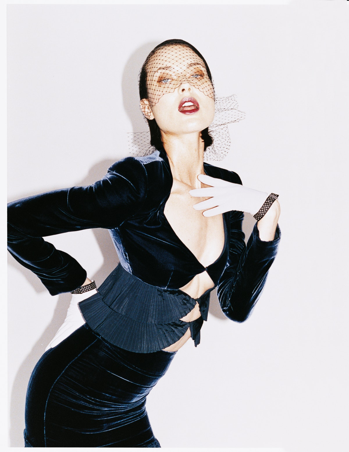 """In """"Cover Girls,"""" page 504, Juergen Teller turns his lens on some familiar faces. Here, Shalom Harlow wears Giorgio Armani's silk velvet suit. Ellen Christine veil; Shaneen Huxham gloves."""