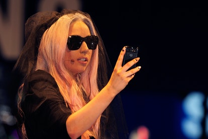 Lady Gaga holding a phone