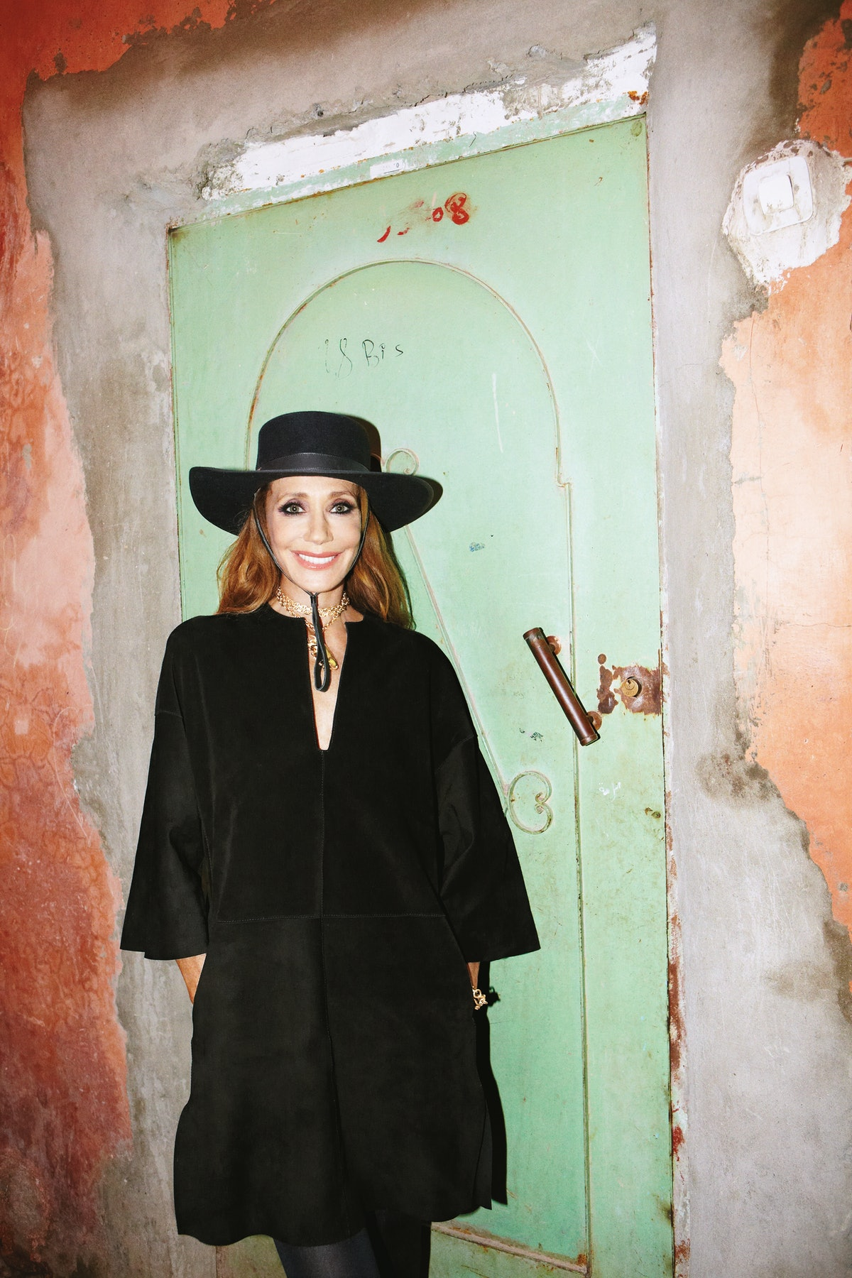 Valentino dress; Valentino Garavani charm necklace and bracelet; Wolford tights; stylist's own hat. For stores, prices, and more, go to wmag.com/marisa-berenson-marrakech.