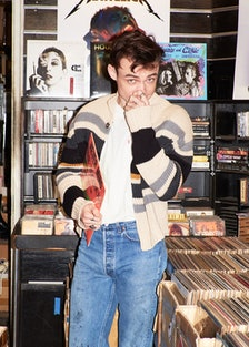 Thomas Doherty stands before a stack of records.