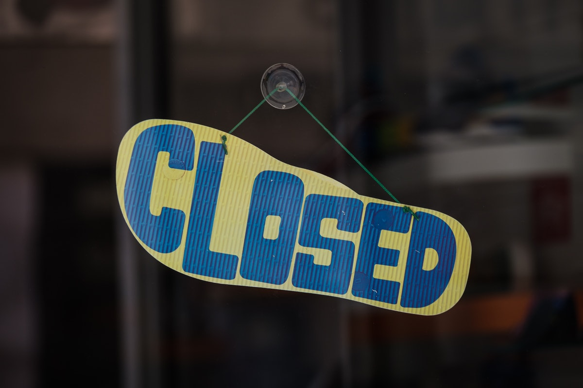 store closed sign on flip flop sole