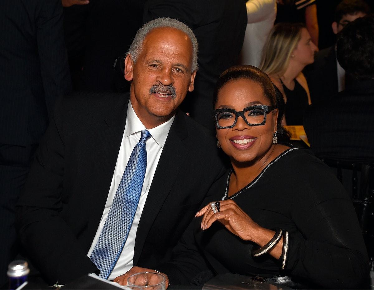 Oprah and Stedman, seated.