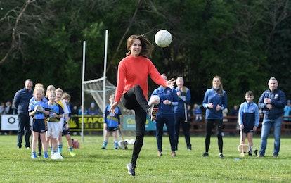 Kate Middleton playing football