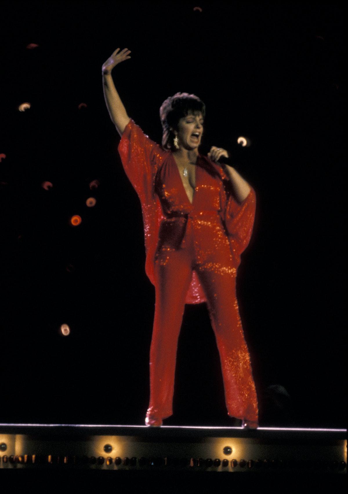 Liza Minnelli in a red jumpsuit.